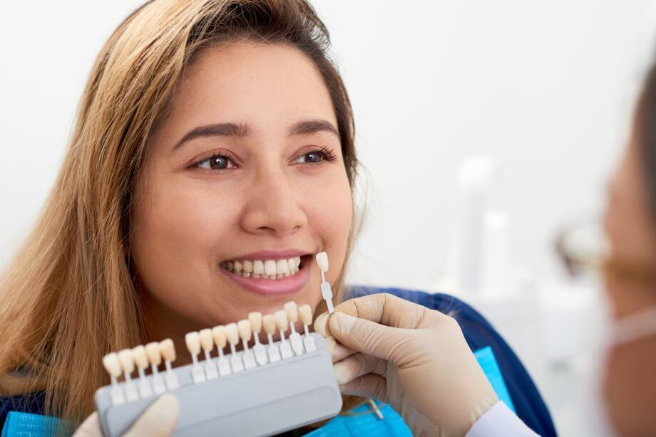 woman picking veneers